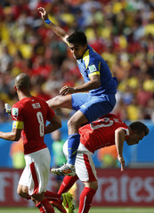Ecuador's Noboa is flanked by Switzerland's Inler and Shaqiri during their 2014 World Cup Group E soccer match at the Brasilia national stadium in Brasilia