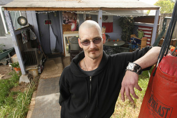 Gary J. Pfleider II stands in front of his shed at the back of his parents home in Lebanon, Oregon
