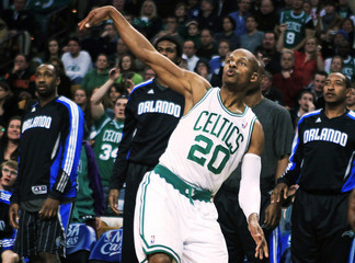 Celtics guard Allen watches a shot go in late in the fourth quarter in front of the Magic bench in their NBA Basketball game in Boston