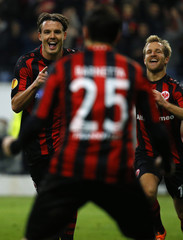 Eintracht Frankfurt's Meier celebrates his goal against Porto with teammates during their Europa League soccer match in Frankfurt