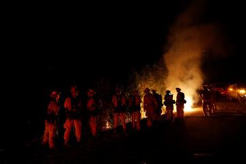 Firefighters battle the Loma Fire near Santa Cruz, California