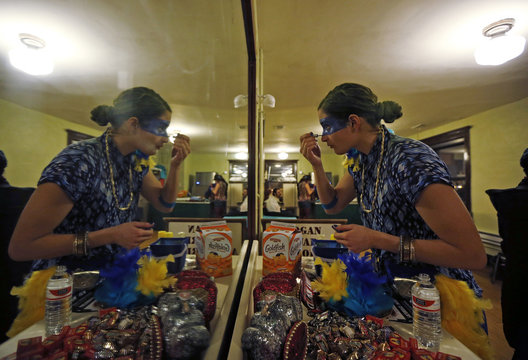 Emilia Garcia is reflected in a mirror as she puts on make-up to take part in the Chicago League of Lady Arm Wrestlers in Chicago