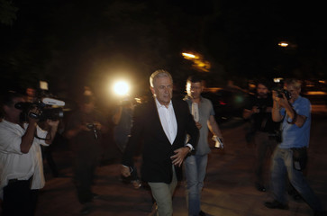 Greece's Foreign Minister Avramopoulos arrives at the Prime Minister's office for a snap cabinet meeting in Athens