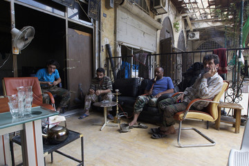 Free Syrian Army fighters rest in Old Aleppo