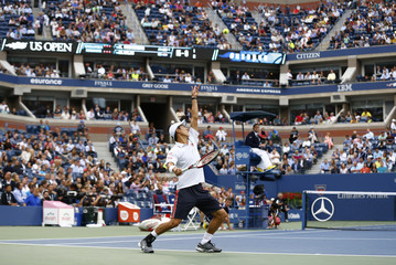 Nishikori of Japan serves to Cilic of Croatia during their men's singles final match at the 2014 U.S. Open tennis tournament in New York