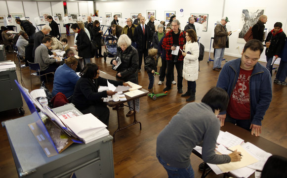People line up to vote in the U.S. presidential election at a polling station set up for those affected by Hurricane Sandy in an art gallery at John Jay College in New York