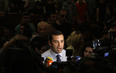 Opposition mayoral candidate Alasania talks to the media during a meeting with supporters in Tbilisi