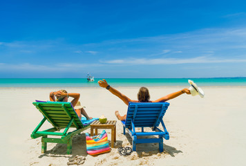 Mature Couple Relaxing in Deck Chairs on Tropical Beach
