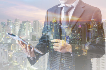 Double exposure of businessman touching with smart phone connected internet and network connection to transport and logistics port in technology trading business and transportation concept