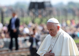 Pope Francis pays respect in front of graves during his visit to Birkenau's former Nazi death camp in Oswiecim