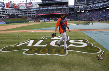 Detroit Tigers shortstop Jhonny Peralta walks over the ALCS logo before the start of Game 1 of the MLB American League Championship Series baseball playoffs against the Texas Rangers in Arlington