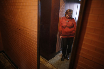 Sirma Antonova is reflected in a mirror as she poses for a picture in her apartment in the town of Blagoevgrad
