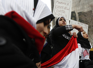 People protest at a rally against Egypt's President Mubarak outside the United Nations building in New York