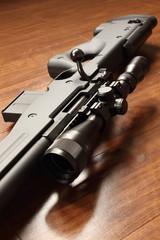 Sniper rifle on the wood floor