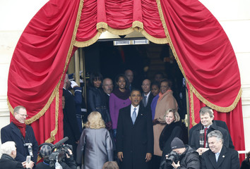 U.S. President Barack Obama turns to look at the crowds gathered on the National Mall as he leaves the podium after his swearing-in ceremonies in Washington