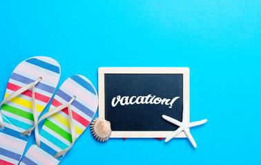sandals, blackboard, seashell and seafish