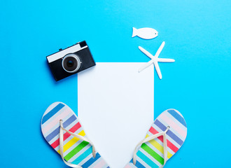 sandals, sheet of paper, camera, starfish and toy