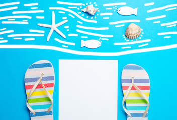 sheet of paper, sandals, starfish, seashells and toys