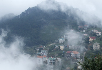 Clouds float over a village in Tam Dao resort town