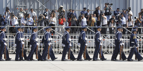 The Chilean honour guard march past the media before a welcome ceremony for U.S. President Obama and his family upon their arrival ceremony in Santiago