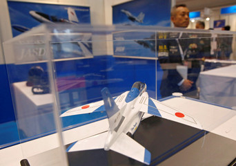 Japan Air Self-Defense Force T-4 jet model is displayed at its booth during Japan Aerospace 2016 air show in Tokyo