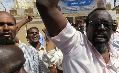 Opposition supporters demonstrate against arrest of Al-Turabi outside his Khartoum headquarters