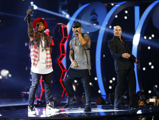 "Wisen performs ""Control"" with Chris Brown and Pitbull at the 15th Annual Latin Grammy Awards in Las Vegas"