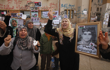 Women mourn during the funeral of people who were killed in a weapons dump attack in Benghazi