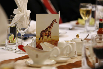 The menu for an official dinner with U.S. President Obama and Tanzanian President Kikwete features an image of a giraffe at the State House in Dar es Salaam