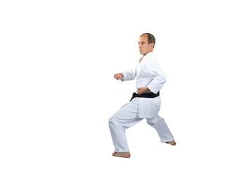 Athlete in karategi is training the karate technique