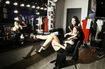Model Jenner poses with her wax figure at Madame Tussauds in London