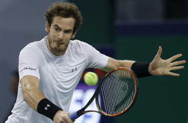 Andy Murray of Britain returns a shot to Tomas Berdych of the Czech Republic during their men's singles quarter-final match at the Shanghai Masters tennis tournament in Shanghai