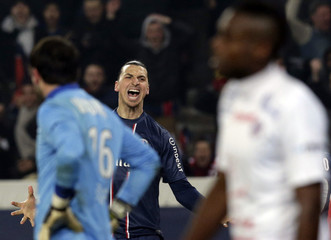 Paris St-Germain's Ibrahimovic reacts after his team mate Gameiro scores a goal against Montpellier during the Ligue 1 soccer match at the Parc des Princes Stadium in Paris