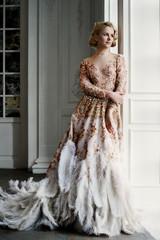 Beautiful lady in luxury dress
