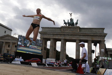 Kappler of Germany competes in the long jump event during the Berlin Flies athletics event in front of the Brandenburg Gate