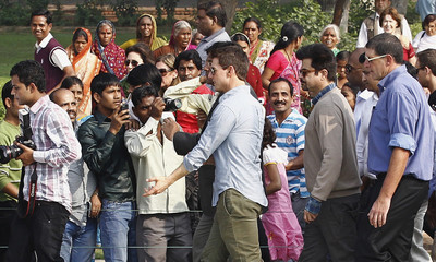 Fans take pictures of actor Cruise at the historic Taj Mahal in the northern Indian city of Agra