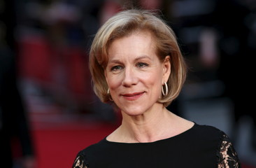 British actress Juliet Stevenson poses for photographers as she arrives at the Olivier Awards at the Royal Opera House in London