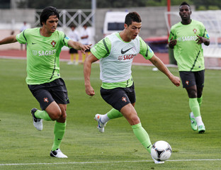 Portugal's Cristinao Ronaldo is challenged by teammate Custodio Castro during their training session at Obidos stadium