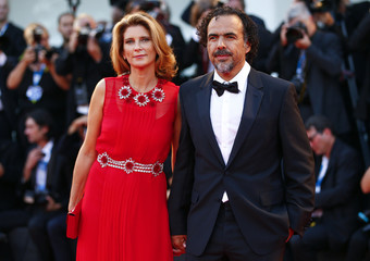 "Director Inarritu poses with her wife Hagerman during the red carpet for the movie ""Birdman or (The unexpected virtue of ignorance)"" at the 71st Venice Film Festival"