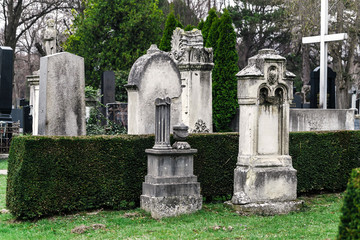 Old Vienna Austrian cemetery architecture with statues and marble tombstones for the graves