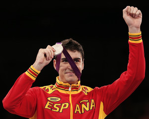 Silver medallist Spain's Nicolas Garcia Hemme poses at the men's -80kg taekwondo victory ceremony during the London Olympic Games at the ExCeL venue