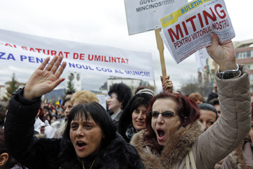 Trade unionists shout slogans during a rally to demand for better roads and labour legislation, in the central Romanian town of Mioveni