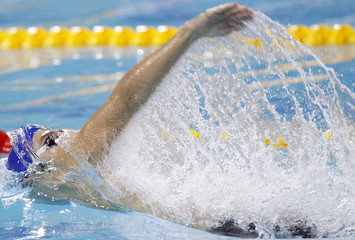 Donets of Russia swims during the Men's 100m Backstroke final at the 10th FINA World Swimming Championships in Dubai