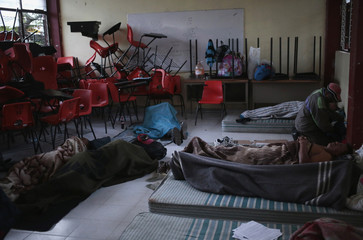 """Men are seen during the early morning in a classroom adapted as a dormitory for the Ayotzinapa Teacher Training College """"Raul Isidro Burgos"""", in Tixtla, in the outskirts of Chilpancingo"""