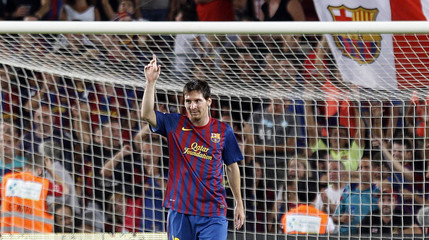 Barcelona's Messi celebrates after scoring a goal against Villarreal during their Spanish first division soccer match in Barcelona