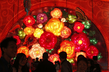 Revellers walk past a flower lantern display ahead of the Chinese New Year celebrations at the Marina Bay in Singapore