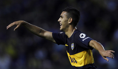 Boca Juniors' Paredes celebrates after scoring a goal against Racing Club in their Argentine First Division soccer match in Buenos Aires