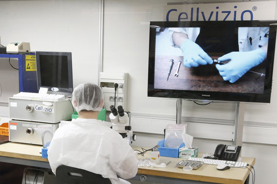 An optical technician works in the production of the Cellvizio, a Medical Endomicroscopy virtual assistant at Mauna Kea Technologies office in Paris