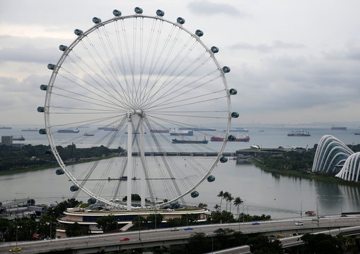 Vessels are pictured behind the Singapore Flyer observatory wheel in the southern coast of Singapore