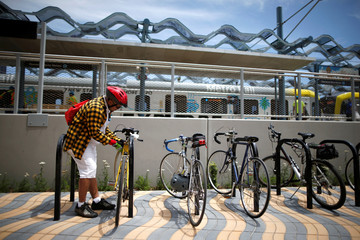 A man secures his bicycle at the Downtown Santa Monica station on L.A. Metro's new $1.5 billion Expo Line extension that connects downtown to the beach for the first time in 63 years, in Santa Monica
